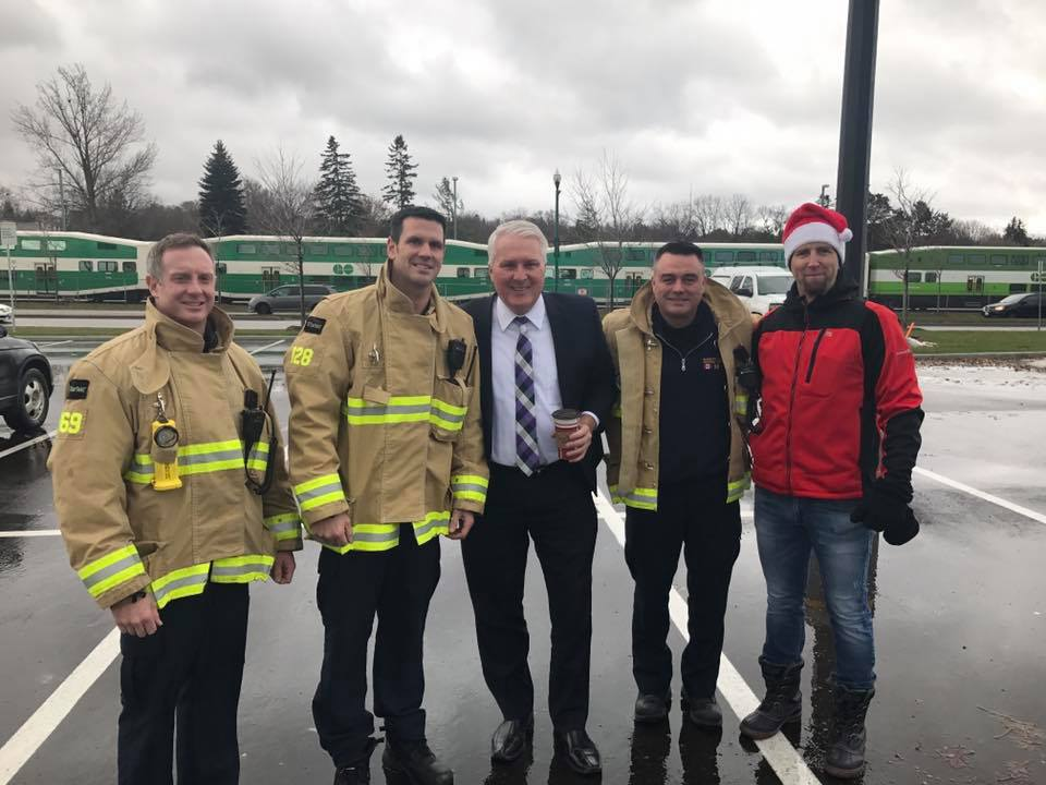At the 4th annual Santa's Helpers Run and toy drive in Barrie on November 25 with organizer Sean Scott of the Barrie Firefighters.