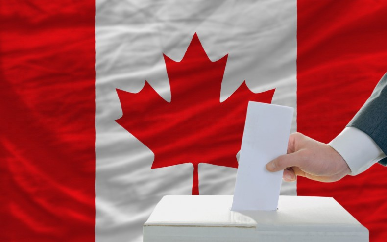 man-putting-ballot-in-a-box-during-elections-in-canada-790x494